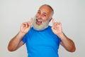 Senior stylish man posing at the camera expressing happiness and Royalty Free Stock Photo