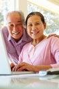 Senior taiwanese couple working on laptop Stock Photos