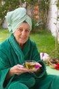 A senior takes her tisane in an open air spa studio Royalty Free Stock Photo