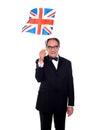 Senior UK supporter holding nations flag Stock Image