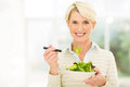Senior vegetarian salad beautiful female eating Stock Images