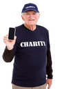 Senior volunteer smart phone cheerful holding on white background Royalty Free Stock Images
