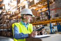 Senior warehouse woman worker with barcode scanner. Royalty Free Stock Photo