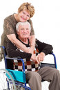 Senior wife husband loving hugging disabled on white background Stock Image