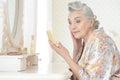 Senior woman applying makeup Royalty Free Stock Photo