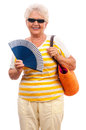 Senior woman with blue fan and shopping bag very happy old in vivid colored clothes orange sun glasses laughing having fun Royalty Free Stock Photo