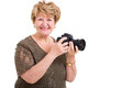 Senior woman camera cheerful holding a digital slr over white background Stock Image
