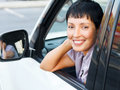 Senior woman in a car smiling Stock Image