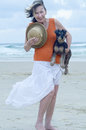 Senior woman carrying pet puppy dog on the beach for day out Royalty Free Stock Photo