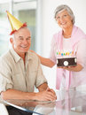 Senior woman celebrating husband's birthday Royalty Free Stock Photo