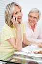 Senior woman with cell phone at Royalty Free Stock Photography