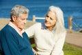 Senior Woman Comforting Depressed Husband Royalty Free Stock Photo