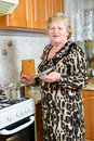 Senior woman cooking at the kitchen Stock Photography