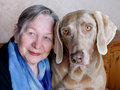 Senior woman and dog Royalty Free Stock Photos