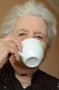 Senior woman drinking coffee Royalty Free Stock Photos