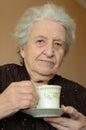 Senior woman drinking coffee Royalty Free Stock Photography