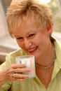 Senior woman drinking milk Royalty Free Stock Photo