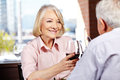 Senior woman drinking wine happy women a glass of red with her husband in a restaurant Royalty Free Stock Photos