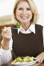 Senior Woman Eating A Healthy Meal Royalty Free Stock Images