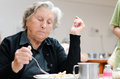 Senior woman eating her lunch Royalty Free Stock Photography