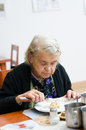 Senior woman eating her lunch at home Royalty Free Stock Photo