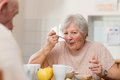 Senior woman eating her lunch at home Stock Photos