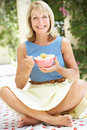 Senior Woman Enjoying Bowl Of Breakfast Cereal Royalty Free Stock Photo