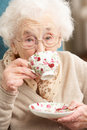Senior Woman Enjoying Cup Of Tea At Home Royalty Free Stock Images