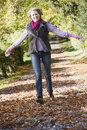 Senior woman enjoying walk through woods Stock Photos