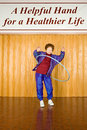 Senior woman exercising with a hula hoop Royalty Free Stock Photo