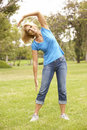 Senior Woman Exercising In Park Stock Photography