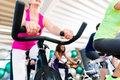 Senior Woman at Fitness Spinning on bike in gym Royalty Free Stock Photo