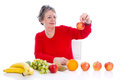 Senior woman with fruit elder woman isolated on white backgrou genetically modified food Royalty Free Stock Photo