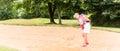 Senior woman at golf having stroke in sand bunker Royalty Free Stock Photo