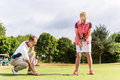 Senior woman and golf pro practicing their sport women Stock Photo