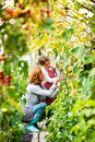 Senior woman with grandaughter gardening in the backyard garden. Royalty Free Stock Photo