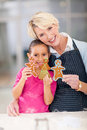 Senior woman granddaughter cookies happy women and holding gingerbread they just baked Royalty Free Stock Photography