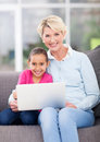 Senior woman granddaughter laptop beautiful women and her using computer at home Stock Photo