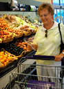 Senior woman in grocery store Royalty Free Stock Photo
