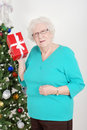 Senior woman guessing her christmas gift Stock Photography