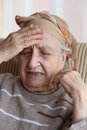 Senior woman has headache Stock Image
