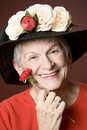 image photo : Senior woman in a hat with flowers