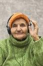 Senior woman with headphones listening to music elderly Stock Photo