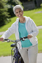 Senior woman with her bicycle Royalty Free Stock Image