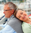 Senior woman with her head on husband's back Royalty Free Stock Photography