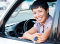 Senior woman holding car key and smiling to you from a Stock Photo
