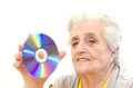 Senior woman holding dvd Stock Photography