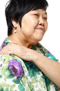 Senior woman holding her aching back Royalty Free Stock Photo