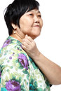 Senior woman holding her aching back Royalty Free Stock Image
