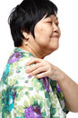 Senior woman holding her aching back Stock Photo